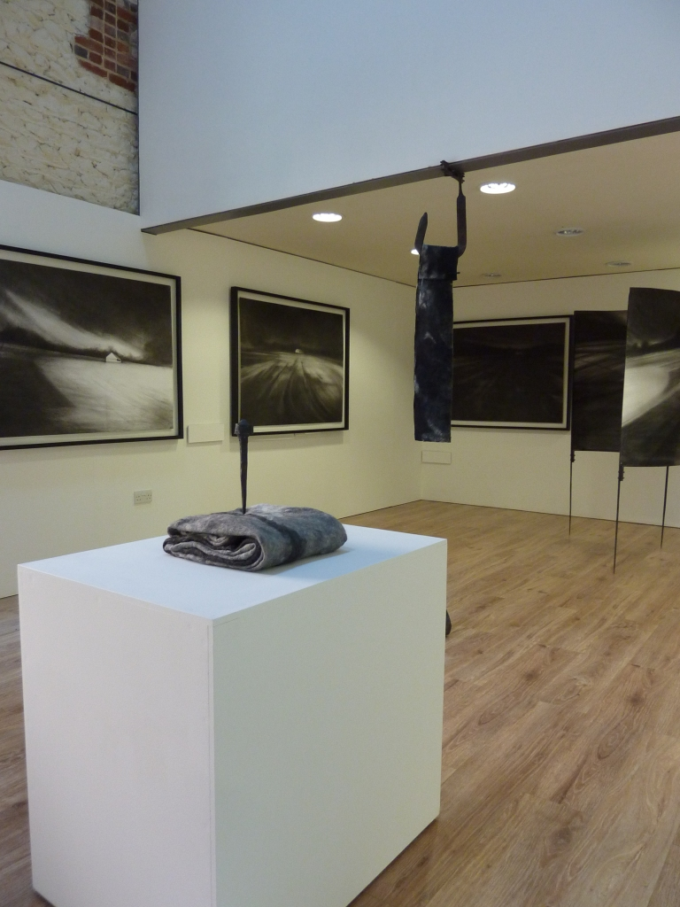 Kate Boucher 'between here and there' series, charcoal drawings, handmade felt and forged metal structures